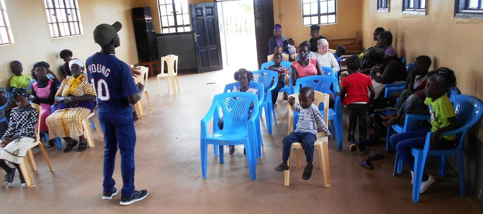Families undergoing spiritual nourishment during Nairobi FHC family fun day